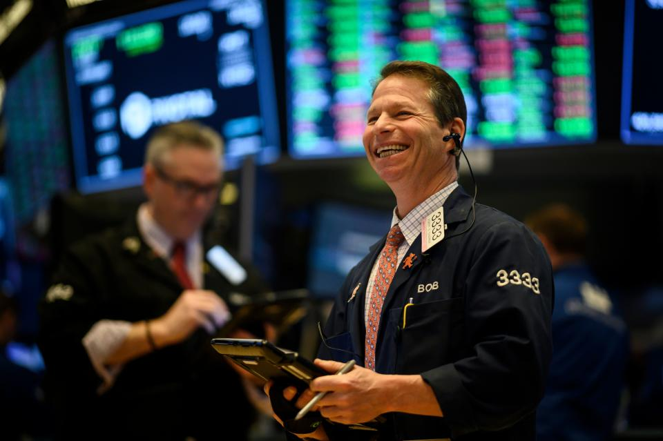 A trader laughs ahead of the closing bell on the floor of the New York Stock Exchange (NYSE) in New York City. Photo: Johannes Eisele/AFP/Getty Images