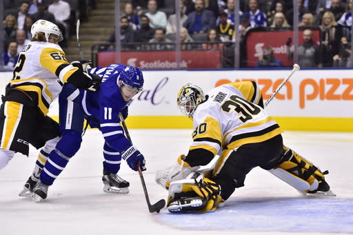 Toronto Maple Leafs centre Zach Hyman (11) is stopped by Pittsburgh Penguins goaltender Matt Murray (30) as Pittsburgh Penguins left wing Carl Hagelin (62) defends during second period NHL hockey action in Thursday, Oct. 18, 2018. (Frank Gunn/The Canadian Press via AP)