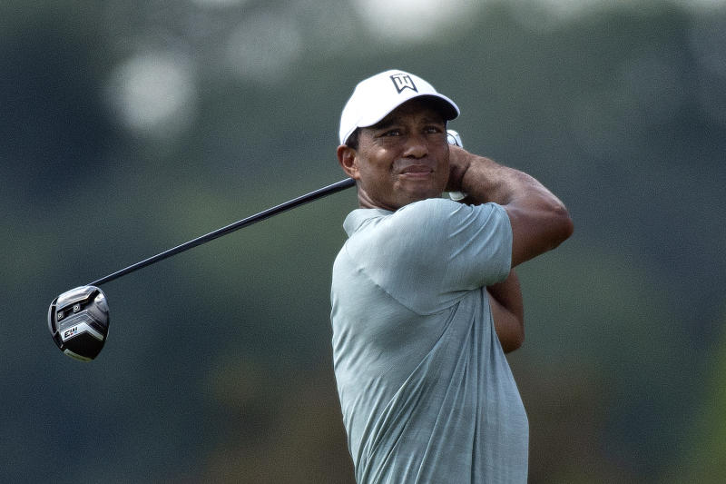 Tiger Woods plays his shot from the third tee during the first round of the BMW Championship golf tournament at Aronimink Golf Club, Thursday, Sept. 6, 2018, in Newtown Square, Pa. (Jose F. Moreno/The Philadelphia Inquirer via AP)
