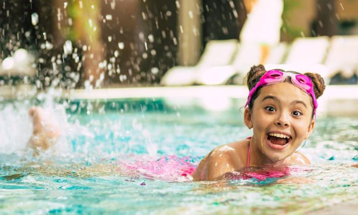Smiling child in swimming pool