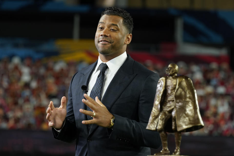 Seattle Seahawks quarterback Russell Wilson speaks after winning the Walter Payton NFL Man of the Year awards at the NFL Honors ceremony as part of Super Bowl 55 Friday, Feb. 5, 2021, in Tampa, Fla. (AP Photo/Charlie Riedel)