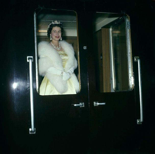 PHOTO: Queen Elizabeth leaves on a train from Liverpool after attending an ice show, May 24, 1961. (George Freston/Fox Photos/Hulton Archive/Getty Images)