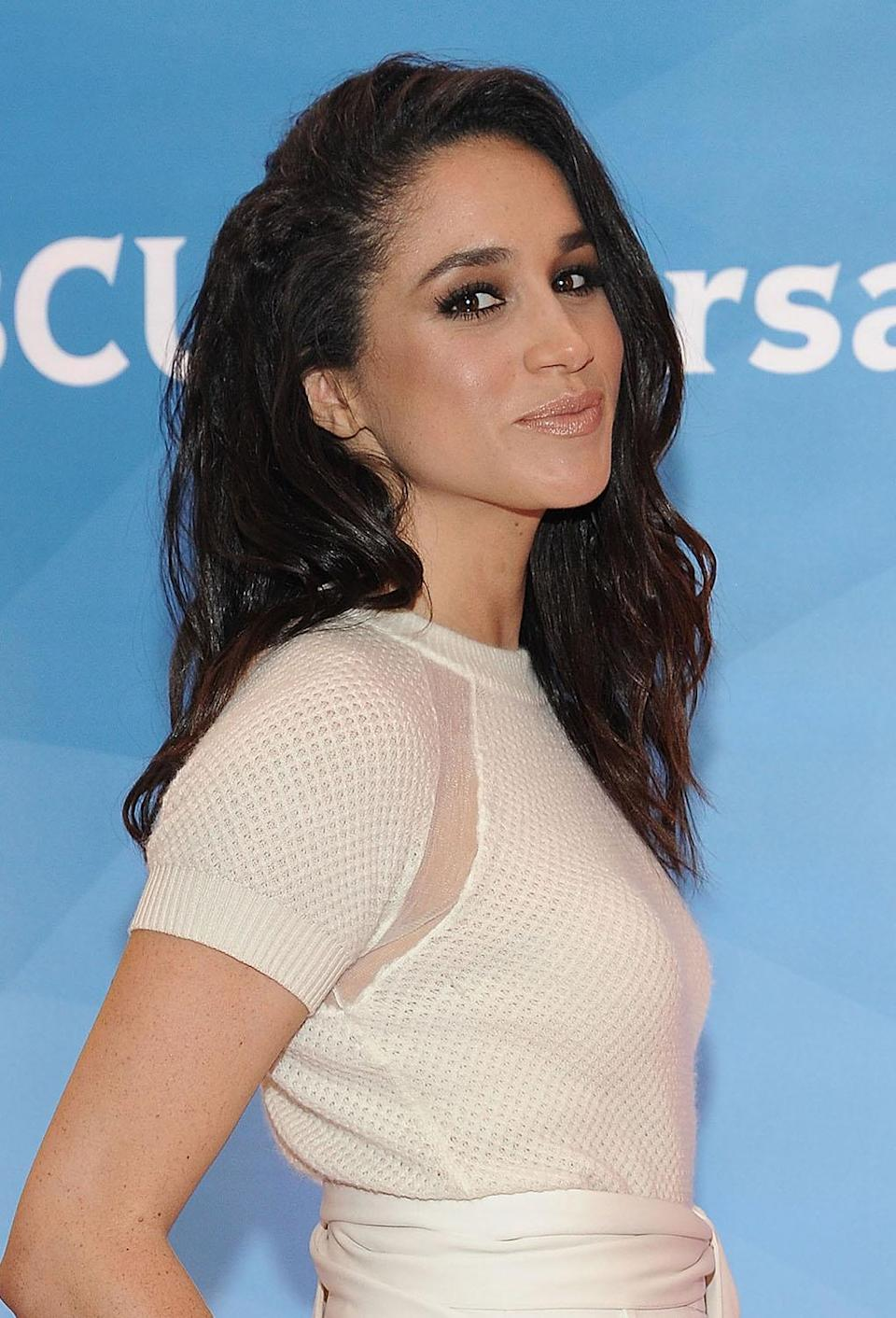 <p>At the NBC New York Summer Press Day in 2015, Markle looked fresh with midlength mermaid waves. (Photo: Daniel Zuchnik/WireImage) </p>
