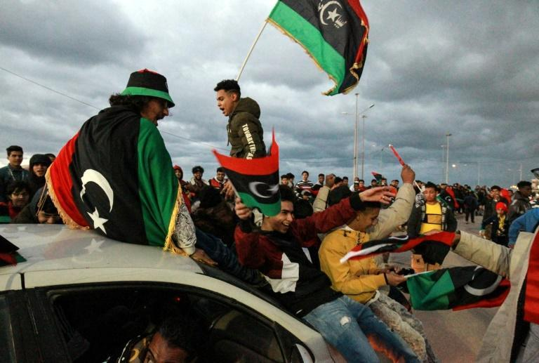 Libyans mark the anniversary of the revolution in the eastern city of Benghazi on Wednesday