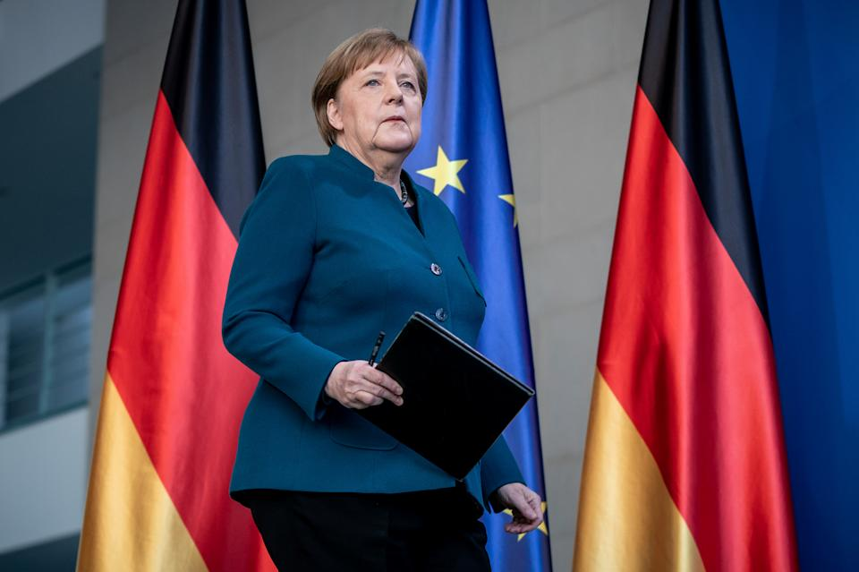 German Chancellor Angela Merkel arrives for a media statement on the spread of the new coronavirus disease (COVID-19) at the Chancellery in Berlin, Germany, March 22, 2020.   Michel Kappeler/Pool via REUTERS