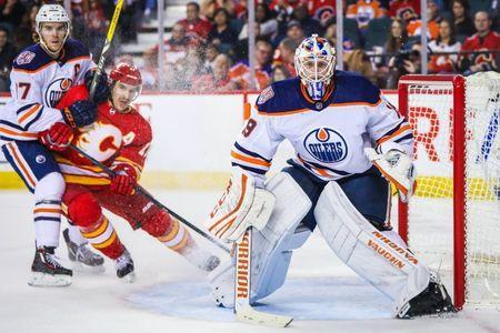 Nov 17, 2018; Calgary, Alberta, CAN; Edmonton Oilers goaltender Mikko Koskinen (19) watches the puck against the Calgary Flames during the third period at Scotiabank Saddledome. Mandatory Credit: Sergei Belski-USA TODAY Sports