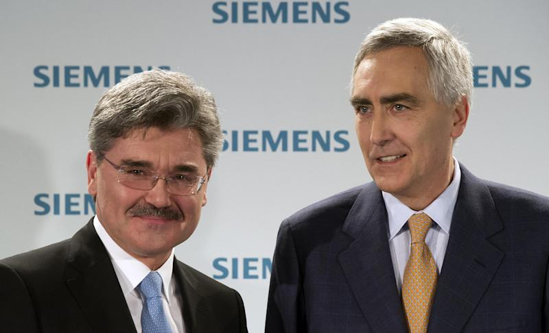 "CEO of  Siemens AG, Peter Loescher, right, and CFO Joe Kaeser attend a press conference in Munich, Germany, Monday Jan. 24, 2012.  Industrial equipment maker Siemens AG said Tuesday that net profit fell 17 percent to 1.46 billion euro ( US $ 1.89 billion) in the final quarter of 2011 due to delays in major wind-power and rail projects, and as the uncertain global economic outlook hurt orders.  Chief executive officer Peter Loescher said the result showed that troubles on financial markets from Europe's debt crisis ""have left their mark on the real economy"" through weaker demand.  (AP Photo/dapd Joerg Koch)"