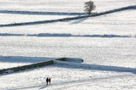 HUDDERSFIELD, UNITED KINGDOM - 2021/01/15: People stop for a photograph on snow-covered fields. Many parts of West Yorkshire are still covered with snow following heavy snowfall the previous day, which caused widespread disruption to travel. (Photo by Adam Vaughan/SOPA Images/LightRocket via Getty Images)