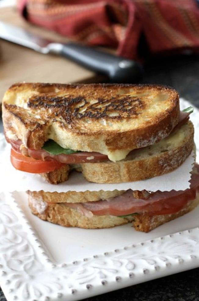 "<p>What do you get when you pair a sandwich with fondue, you ask? A true masterpiece! This rich recipe will cure your lunch cravings and squash your dinner hankerings after just one bite. </p> <p><strong>Get the recipe</strong>: <a href=""https://www.cookincanuck.com/grilled-cheese-sandwich-with-jarlsberg-fondue-ham-tomato-recipe/"" class=""link rapid-noclick-resp"" rel=""nofollow noopener"" target=""_blank"" data-ylk=""slk:grilled cheese sandwich with Jarlsberg fondue, ham, and tomato"">grilled cheese sandwich with Jarlsberg fondue, ham, and tomato</a></p>"