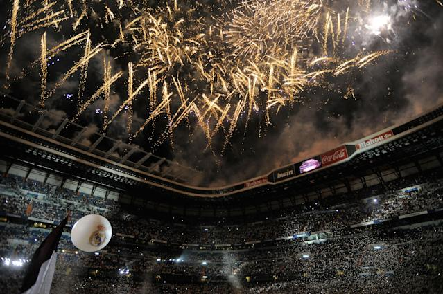 MADRID, SPAIN - MAY 13: Fireworks explode over the Santiago Bernabeu stadium during celebrations of the La Liga title after the La Liga match between Real Madrid CF and RCD Mallorca at Estadio Santiago Bernabeu on May 13, 2012 in Madrid, Spain. (Photo by Denis Doyle/Getty Images)