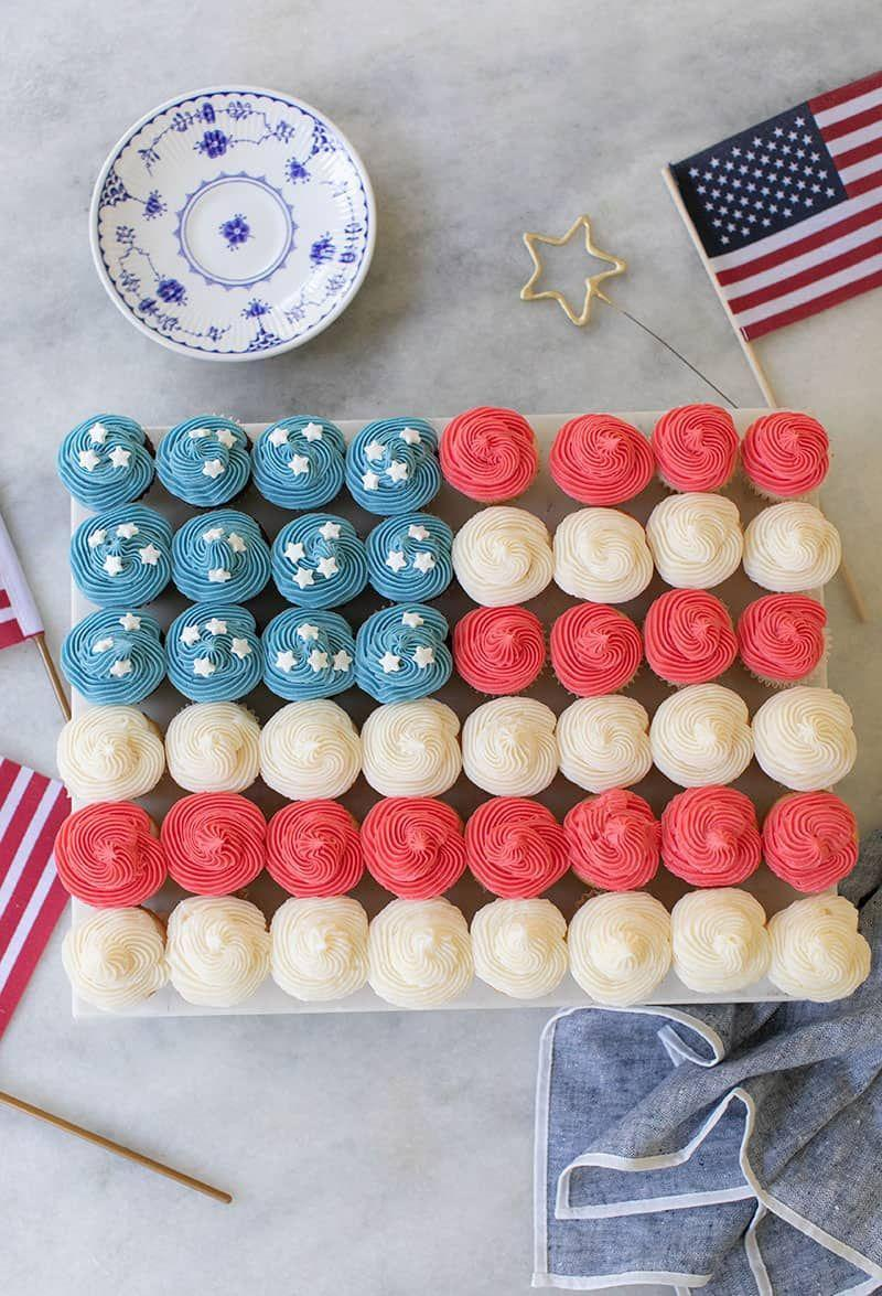 """<p>Make your cupcakes work together to create a pretty flag """"cake""""! Just frost them in groups of red, white, and blue, top some with star sprinkles and arrange them in the pattern of the American flag.</p><p><strong>Get the recipe at <a href=""""https://sugarandcharm.com/flag-cupcake-cake"""" rel=""""nofollow noopener"""" target=""""_blank"""" data-ylk=""""slk:Sugar and Charm"""" class=""""link rapid-noclick-resp"""">Sugar and Charm</a>.</strong><br><br><a class=""""link rapid-noclick-resp"""" href=""""https://go.redirectingat.com?id=74968X1596630&url=https%3A%2F%2Fwww.walmart.com%2Fsearch%2F%3Fquery%3DPLATTERS&sref=https%3A%2F%2Fwww.thepioneerwoman.com%2Ffood-cooking%2Frecipes%2Fg36343624%2F4th-of-july-cupcakes%2F"""" rel=""""nofollow noopener"""" target=""""_blank"""" data-ylk=""""slk:SHOP PLATTERS"""">SHOP PLATTERS</a></p>"""