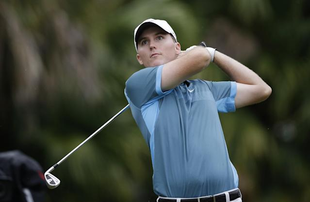 Russell Hunley watches from the 13th tee during the first round of the Cadillac Championship golf tournament Thursday, March 6, 2014, in Doral, Fla. (AP Photo/Wilfredo Lee)