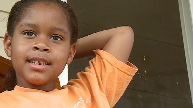 In this Monday, April 16, 2012 image made from video and provided by WMAZ-13 TV, kindergartner Salecia Johnson, 6, is shown at her home near Milledgeville, Ga. Police in Georgia handcuffed the kindergartner after the girl threw a tantrum, and the police chief is making no apologies. Johnson is accused of tearing items off the walls and throwing furniture at school in the central Georgia city of Milledgeville. The police report says the girl knocked over a shelf that injured the principal. (AP Photo/WMAZ-13 TV) MANDATORY CREDIT