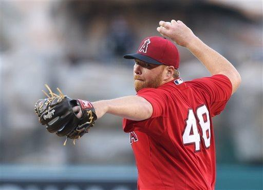 Los Angeles Angels starterTommy Hanson delivers a pitch in the first inning of an exhibition baseball game against the Los Angeles Dodgers in Anaheim, Calif., on Saturday, March 30, 2013. (AP Photo/Christine Cotter)