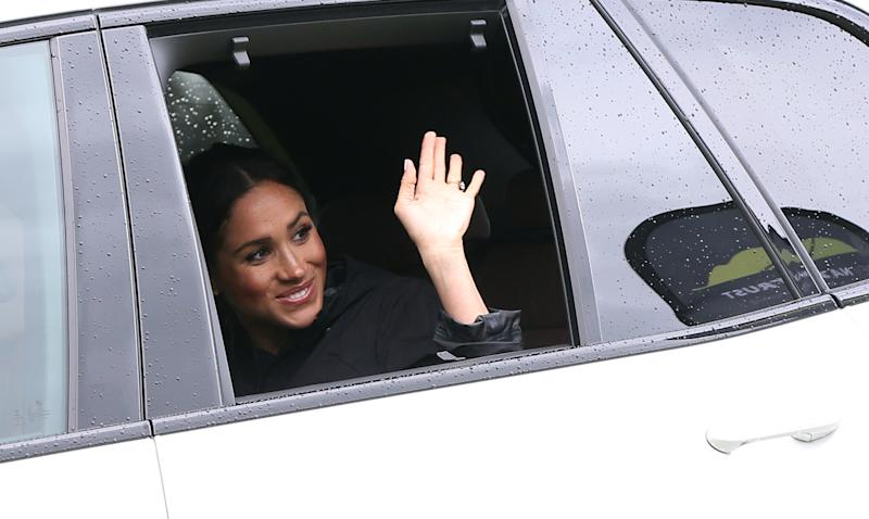 Meghan, Duchess of Sussex waves as she leaves the Dedication to the Queens Commonwealth Canopy at the North Shore Riding Club in Auckland on October 30, 2018. - The Duke and Duchess of Sussex are on their official 16-day Autumn tour visiting cities in Australia, Fiji, Tonga and New Zealand. (Photo by MICHAEL BRADLEY / AFP) (Photo credit should read MICHAEL BRADLEY/AFP via Getty Images)