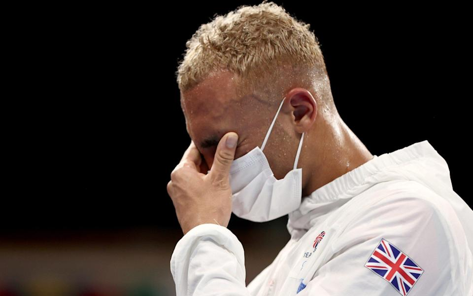Ben Whittaker takes off silver medal in disgust during boxing ceremony: 'I felt embarrassed' - REUTERS