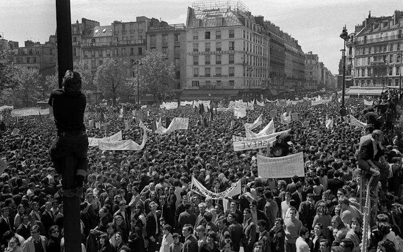 Students and workers demonstrate between Republique and Denfert Rochereau squares onMay 13, 1968 - AFP