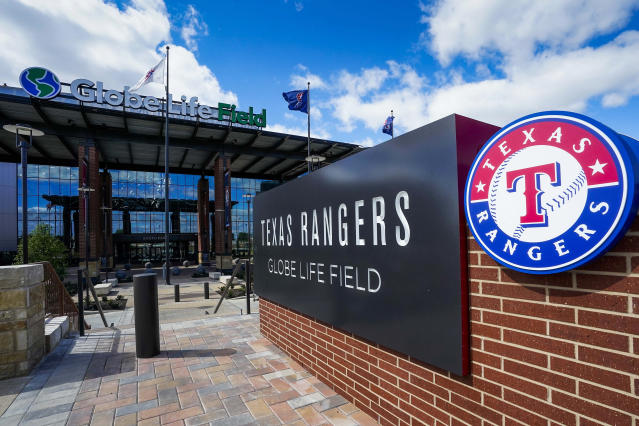 This photo shows an exterior view of an entrance to Globe Life Field in Arlington, Texas, Tuesday, March 31, 2020. The Texas Rangers would have played the Los Angeles Angels on Tuesday, in what would have been the opening day for the new ballpark, before the season was postponed due to the new coronavirus. (Smiley N. Pool/The Dallas Morning News via AP, Pool)