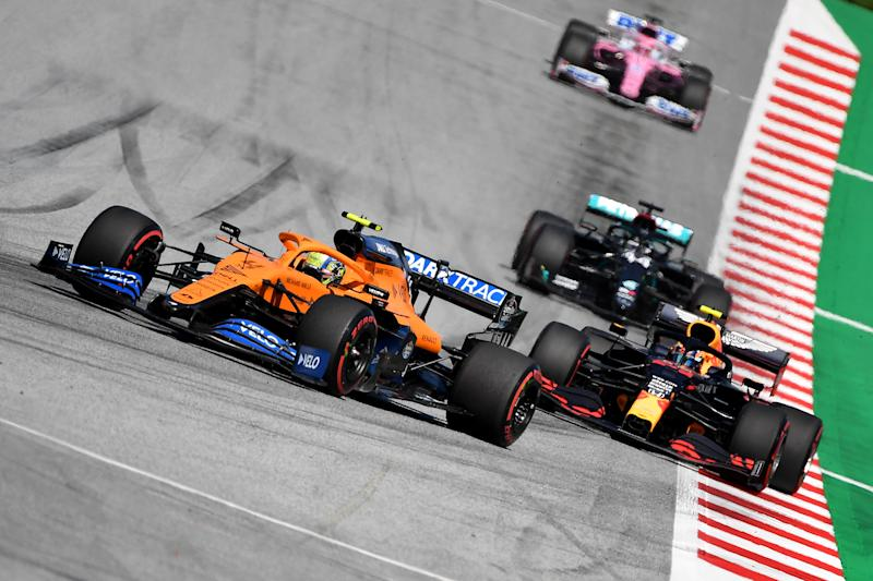 McLaren's British driver Lando Norris steers his car in front of Red Bull's Thai driver Alex Albon during the Austrian Formula One Grand Prix race on July 5, 2020 in Spielberg, Austria. (Photo by JOE KLAMAR / various sources / AFP) (Photo by JOE KLAMAR/AFP via Getty Images)