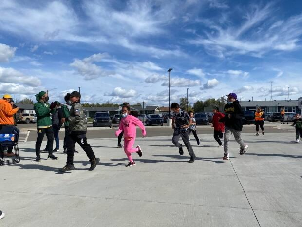 Students participate at Thursday's opening of the maskêkosihk Hub in Enoch Cree Nation, located west of Edmonton.  (Jered Stuffco/ CBC Edmonton - image credit)