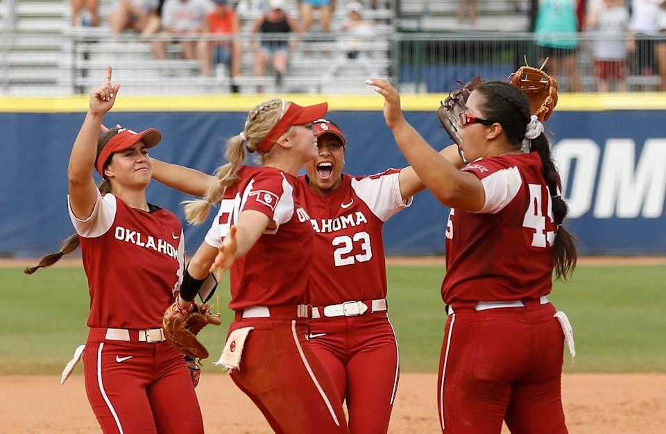 Oklahoma celebrates after defeating James Madison in the NCAA Women's College World Series semifinals.