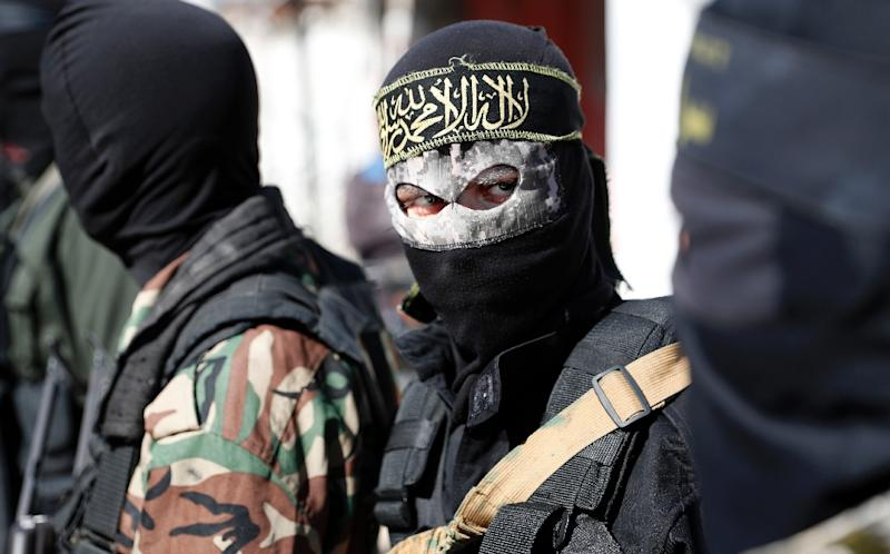 Members of the Palestinian Islamic Jihad Movement and masked militants attend the funeral of comrades killed in an Israeli operation to blow up a tunnel stretching from the Gaza Strip into Israel in central Gaza, on October 31, 2017