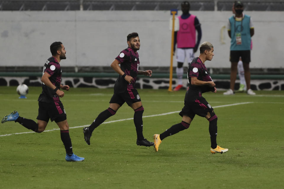 Mexico's Uriel Antuna, right, celebrates scoring his side's opening goal against United during a Concacaf Men's Olympic Qualifying championship soccer match in Guadalajara, Mexico, Wednesday, March 24, 2021. (AP Photo/Fernando Llano)