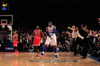 NEW YORK, NY - APRIL 08: Carmelo Anthony #7 of the New York Knicks celebrates his game winning three pointer against as Luol Deng #9 of the Chicago Bulls looks on at Madison Square Garden on April 8, 2012 in New York City. (Photo by Chris Trotman/Getty Images)
