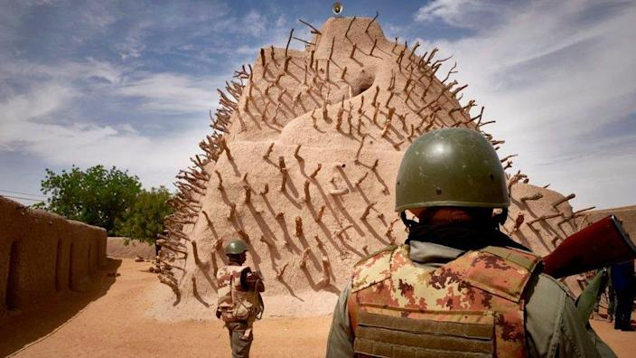 Soldiers of the Malian army patrol the archaeological site of the Tomb of Askia in Gao on March 10, 2020.