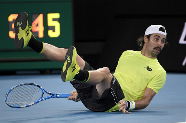 Australia's Jordan Thompson falls during his second round singles match against Italy's Fabio Fognini at the Australian Open tennis championship in Melbourne, Australia, Wednesday, Jan. 22, 2020. (AP Photo/Andy Brownbill)