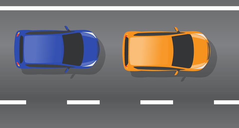 A blue car is pictured behind an orange car.
