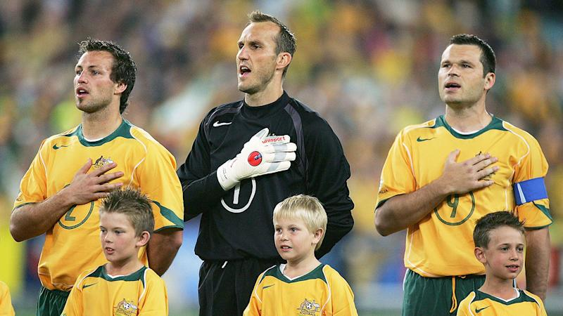 Pictured right, Lucas Neill became Socceroos captain after Mark Viduka retired.
