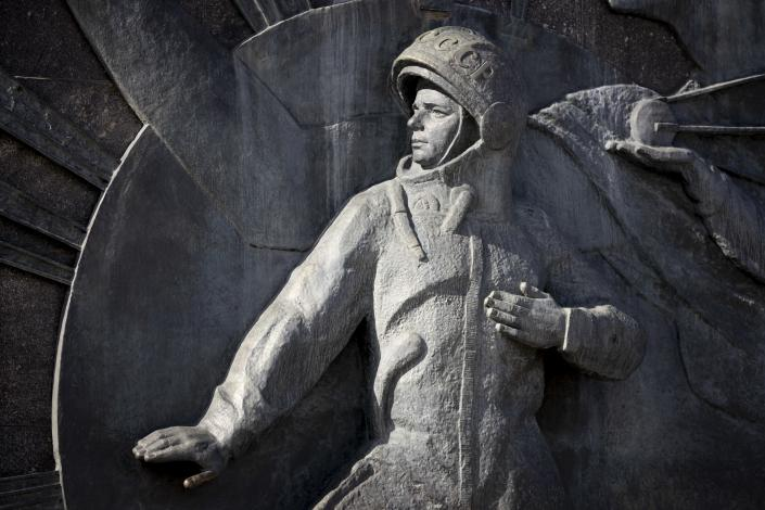The bas-relief of Yuri Gagarin, the first person who flew to space, as part of a 107-meter (351-feet) high titanium obelisk depicting a starting rocket dedicated to the first cosmonauts opened in Moscow 1964, in Moscow, Russia, Sunday, March 28, 2021. From a giant statue towering over Moscow to a more modest monument on the Sakhalin Island in the Pacific Ocean, dozens of memorials across Russia commemorate Yuri Gagarin, the cosmonaut who became the first person in space on April 12, 1961, 60 years ago. (AP Photo/Alexander Zemlianichenko)