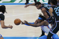 Oklahoma City Thunder forward Luguentz Dort (5) passes in front of Sacramento Kings guard Buddy Hield (24) in the first half of an NBA basketball game Tuesday, May 4, 2021, in Oklahoma City. (AP Photo/Sue Ogrocki)