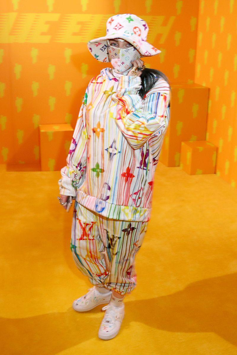 <p>Billie continues to push fashion boundaries in a rainbow paint-drip look, complete with a face mask and matching bucket hat. </p>