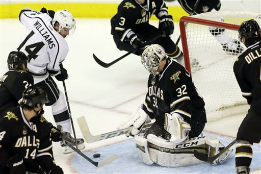 Los Angeles Kings forward Justin Williams (14) shoots a goal against Dallas Stars goalie Kari Lehtonen (32), of Finland, during the third period of an NHL hockey game in Dallas on Sunday, March 31, 2013. (AP Photo/Mike Fuentes)