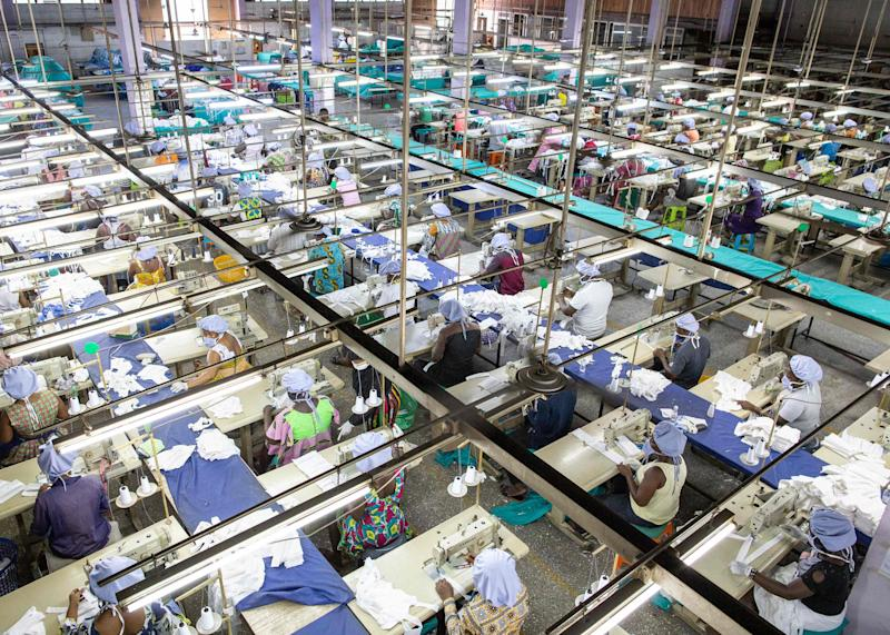 An aerial shot of a factory showing people cutting and sewing masks.