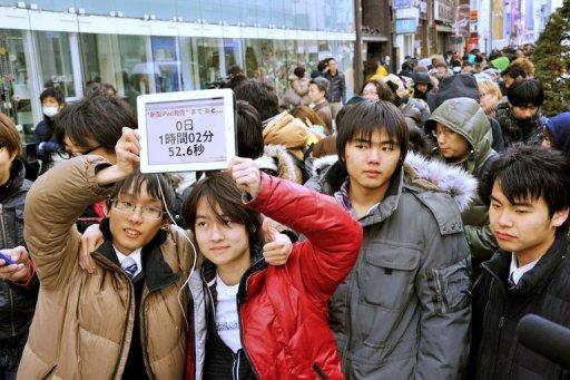 Apple fans are seen displaying a countdown clock as they wait for the launch of the new iPad at an Apple store in Tokyo, on March 16. Hundreds of gadget lovers queued up for the new device as a worldwide launch followed the global sunrise