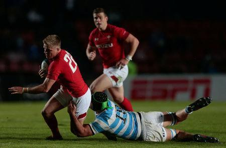 Rugby Union - June Internationals - Argentina v Wales - Brigadier General Estanislao Lopez Stadium, Santa Fe, Argentina - June 16, 2018 - Wales' Gareth Anscombe is tackled by Argentina's Matias Alemanno. REUTERS/Diego Lima