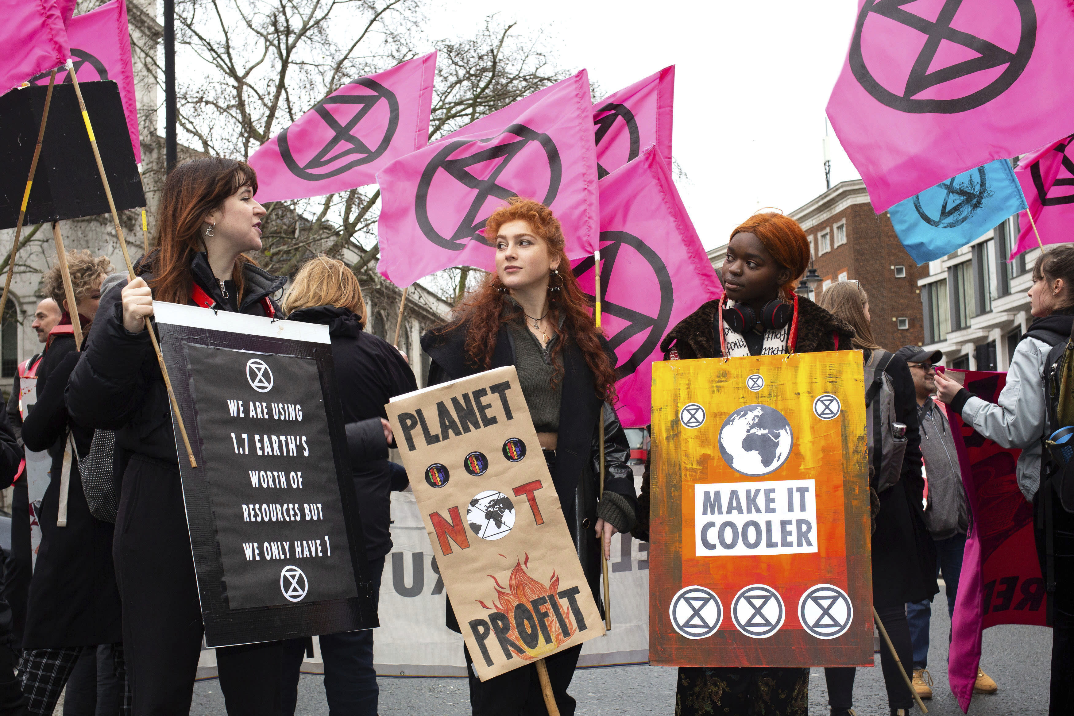 People gather in central London for an Extinction Rebellion protest during London Fashion Week, in London Saturday Feb. 15, 2020. The environmental pressure group Extinction Rebellion are targeting what they allege is the global impact from the ephemeral fashion industry.(Katie Collins/( / PA via AP)