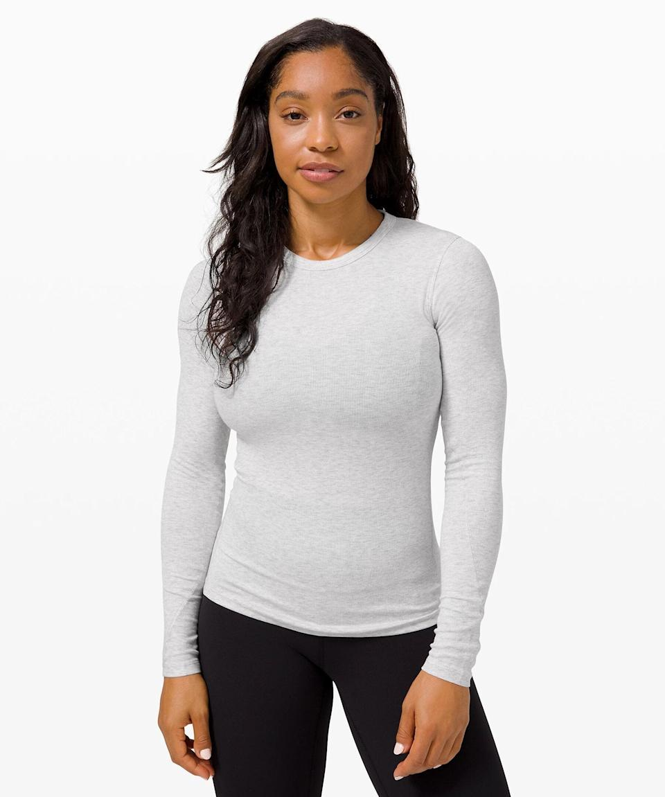 """<h3>Hold Tight Long Sleeve Rib<br></h3><br>A modal-blend rib knit and a fitted silhouette makes this second-skin long sleeve the ultimate layering piece.<br><br><strong>What They're Saying:</strong> """"Wow, I'm super impressed with this top. I ordered the black and absolutely love the fit. The fabric is stretchy in a good way and the fit is very flattering. Hugs and stretches in all the right places. Please make more colors!""""<br><br><strong>lululemon</strong> Hold Tight Long Sleeve, $, available at <a href=""""https://go.skimresources.com/?id=30283X879131&url=https%3A%2F%2Fshop.lululemon.com%2Fp%2Ftops-long-sleeve%2FHold-Tight-Long-Sleeve-Rib%2F_%2Fprod9960703%3Fcolor%3D32493"""" rel=""""nofollow noopener"""" target=""""_blank"""" data-ylk=""""slk:lululemon"""" class=""""link rapid-noclick-resp"""">lululemon</a>"""
