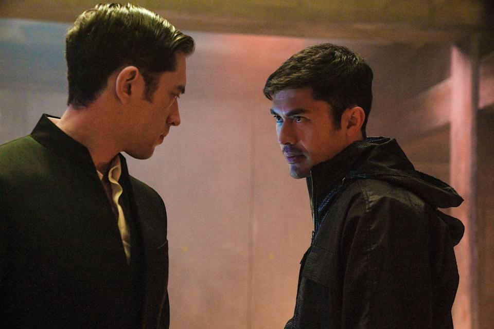 """A betrayal tears apart the friendship of Tommy (Andrew Koji, left) and Snake Eyes (Henry Golding) in """"Snake Eyes."""""""