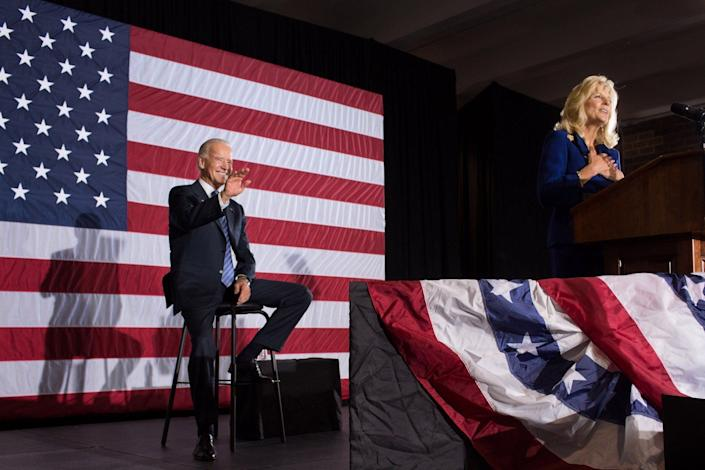 Biden smiles and waves as his wife, Dr. Jill Biden, introduces him at an event in Lynchburg, Virginia, on Oct. 27, 2012.