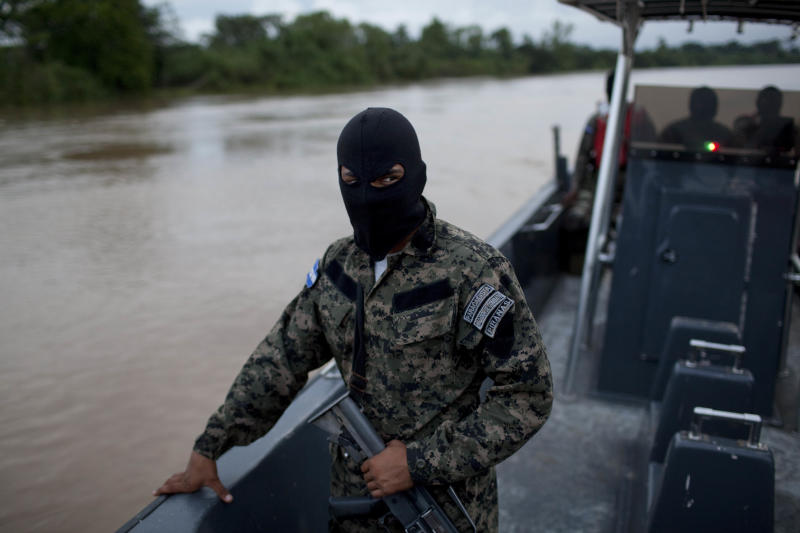 Honduran Navy officers patrol in Patuca river, near Ahuas, a remote community in La Mosquitia region, Honduras, Monday, May 21, 2012. On Friday May 11, a joint Honduran-U.S. drug raid, on a helicopter mission with advisers from the DEA, appears to have mistakenly targeted civilians in the remote jungle area, killing four riverboat passengers and injuring four others. Later, according to villagers, Honduran police narcotics forces and men speaking English spent hours searching the small town of Ahuas for a suspected drug trafficker.(AP Photo/Rodrigo Abd)