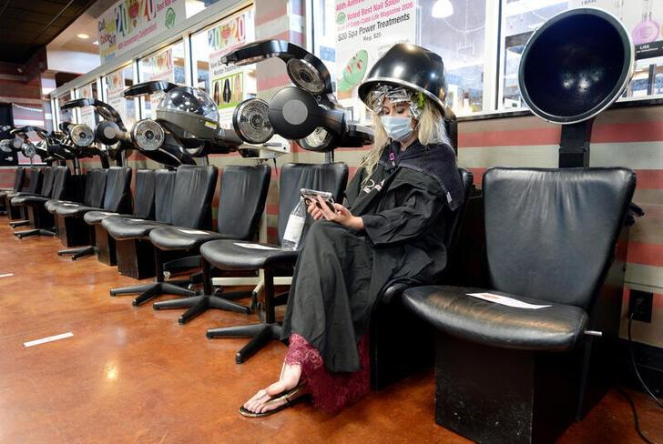 Sign here first: U.S. salons, gyms, offices require coronavirus waivers