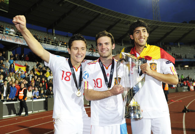Spain's players Daniel Parejo (R), Juan Mata (C) and first goal scorer Ander Herrera celebrate with the trophy at the end of the UEFA Under-21 European Championship final football match Spain vs Switzerland at the Aarhus Stadium, on June 25, 2011. Spain win the final with 2-0.AFP PHOTO/JONATHAN NACKSTRAND (Photo credit should read JONATHAN NACKSTRAND/AFP/Getty Images)