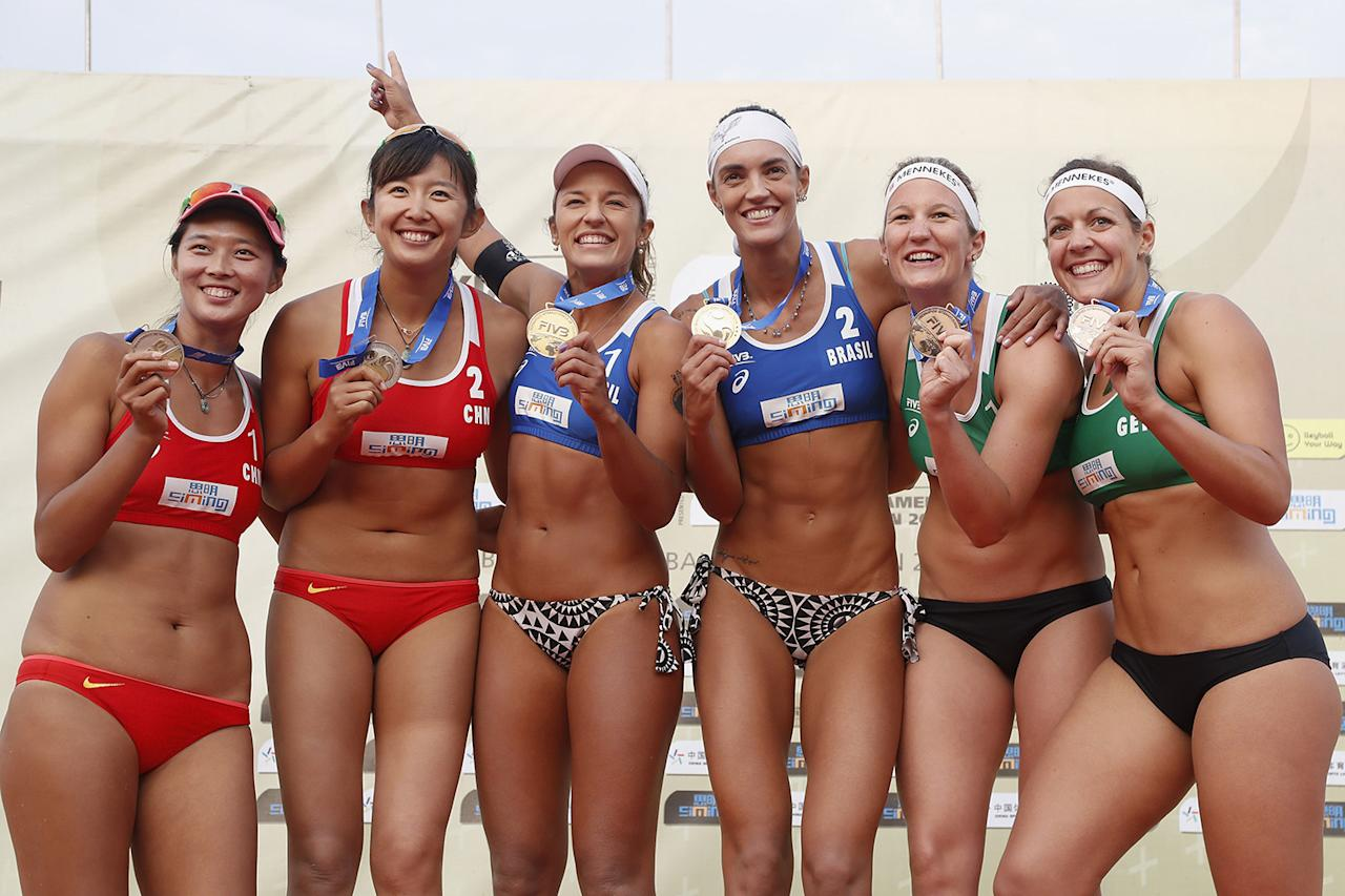 <p>From left, Fan Wang and Yuan Yue of China, Barbara Seixas De Freitas and Fernanda Alves of Brazil, and Isabel Schneider and Victoria Bieneck of Germany, pose with their medals at the podium of the FIVB Beach Volleyball World Tour Xiamen Open 2017 in Xiamen, China, April 23, 2017. (Kevin Lee/Getty Images) </p>