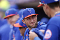 FILE - In this Feb 22, 2020, file photo, New York Mets' Tim Tebow looks back in the dugout during a spring training baseball game against the Miami Marlins in Port St. Lucie, Fla. Tebow and coach Urban Meyer are together again, this time in the NFL and with Tebow playing a new position. The former Florida star and 2007 Heisman Trophy-winning quarterback signed a one-year contract with the Jacksonville Jaguars on Thursday, May 20, 2021, and will attempt to revive his pro career as a tight end. (AP Photo/Vera Nieuwenhuis, File)