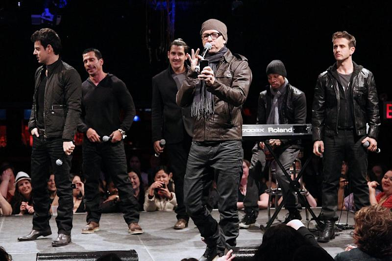 """In this picture provided by Starpix, New Kids on the Block members, from left, Jordan Knight, Danny Wood, Jonathan Knight, Donnie Wahlberg, and Joey McIntyre, far right, perform during the announcement of """"The Package Tour,"""" Tuesday, Jan. 22, 2013 in New York. The major summer tour will feature New Kids on the Block, 98 Degrees and Boyz II Men. (AP Photo/Starpix, Kristina Bumphrey)"""