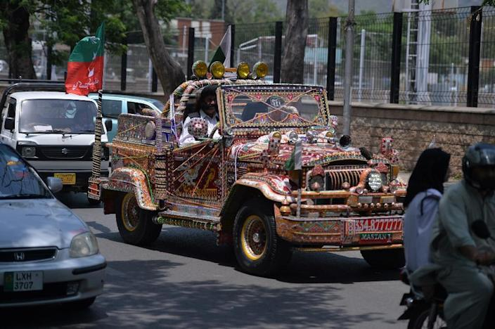 Mastan Khan Wazir, 70, who has 22 children from his three wives, drives his blinged-out jeep in Islamabad. (AFP Photo/AAMIR QURESHI)